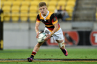 Damian McKenzie runs with the ball during the Mitre 10 Cup match against Wellington. Photo / photosport.nz