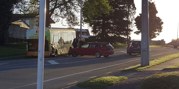 A car and a bus have collided on Welcome Bay Rd this morning. Photo/Supplied.
