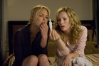 Alison (Katherine Heigl, left) and her sister, Debbie (Leslie Mann) take a number of pregnancy tests in Knocked Up.