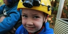 The writer's son Leo all kitted up for caving. Photo / Bronwyn Sell