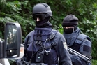 Police commandos carried out raids in Chemnitz. Photo / AP