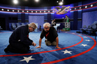 Workers prepare the stage for the second presidential debate between Republican presidential nominee Donald Trump and Democratic presidential nominee Hillary Clinton in St Louis. Photo / AP