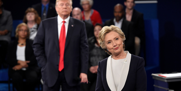 Democratic presidential nominee Hillary Clinton, right, and Republican presidential nominee Donald Trump  during the second presidential debate. Photo / AP