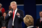 Republican presidential nominee Donald Trump points at Democratic presidential nominee Hillary Clinton during the second presidential debate. Photo / AP