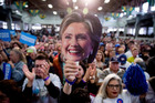 A member of the audience holds up a mask depicting Democratic presidential candidate Hillary Clinton as she speaks in Pueblo, Colorado. Photo / AP