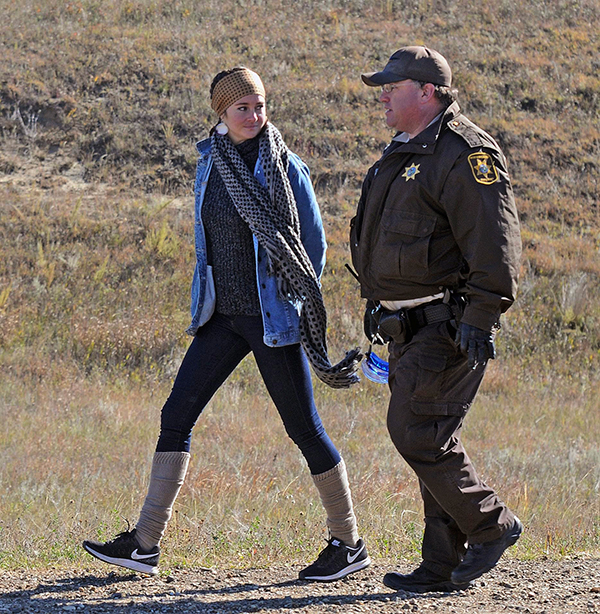 A Morton County Sheriff's deputy officer arrests actress Shailene Woodley at a protest against the Dakota Access Pipeline. Photo / AP