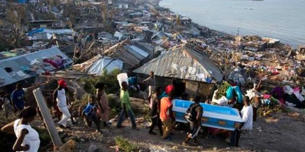Residents carry a coffin containing the remains of a pregnant woman, a victim of Hurricane Matthew, in Jeremie, Haiti. Photo / AP