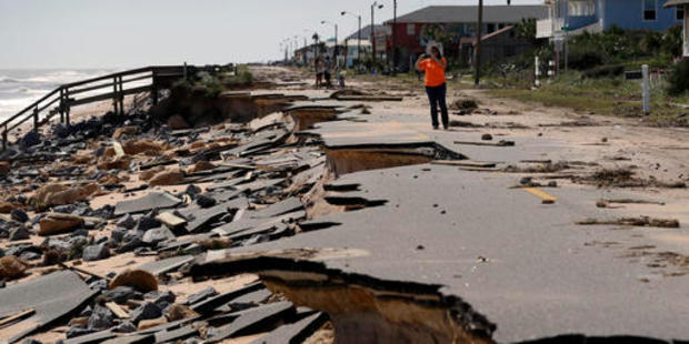 Onlookers walk along a section of highway A1A that was washed out by Hurricane Matthew in Flagler Beach, Florida. Photo / AP