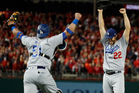 Los Angeles Dodgers pitcher Clayton Kershaw (22) and catcher Carlos Ruiz celebrate after Washington Nationals' Wilmer Difo struck out to end Game 5. Photo / AP