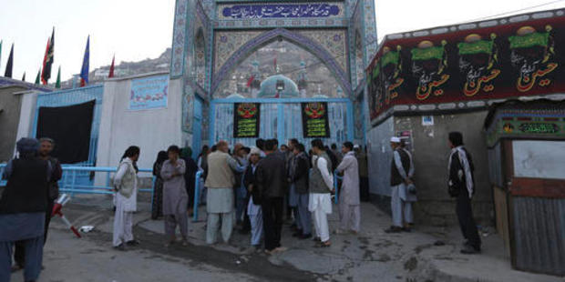Afghans stand in front of Kart-e-Sakhi shrine after a militant attack in Kabul, Afghanistan. More than a dozen people were killed in the attack. Photo / AP