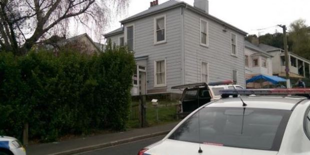 Police cars at the scene in Leckhampton Court. Photo / Otago Daily Times / Tim Brown