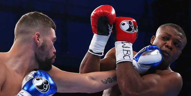 Tony Bellew lands a left shot on Illunga Makabu during the Vacant WBC World Cruiserweight Championship fight. Photo / Getty Images.