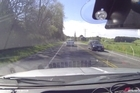 Dash-cam video that caught the South Island police chase of a man driving a blue Subaru