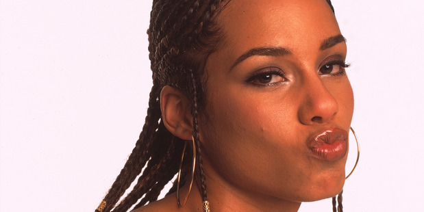 Portrait of singer Alicia Keys wearing more makeup in New York, 2001. Photo / Getty