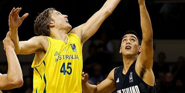 Tai Wynyard of the Tall Blacks competes against Ryan Broekhoff of the Boomers. Photo / Getty Images