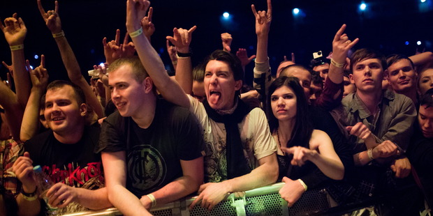 Fans cheer during a concert by the American heavy metal band Slipknot at the Olimpiysky Arena. Photo / Getty