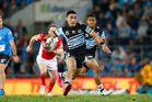 Valentine Holmes of the Sharks in action. Photo / Getty Images