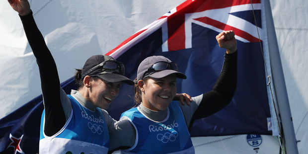 Jo Aleh (left) and Polly Powrie celebrate winning the silver medal at the Rio Games. Photo / Getty Images