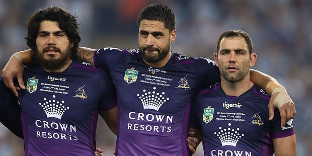 Tohu Harris (L) with Kiwis captain Jesse Bromwich and Storm teammate Cameron Smith. Photo / Getty Images