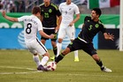 Michael McGlinchey battles for possession with Jesus Molina of Mexico. Photo / Getty