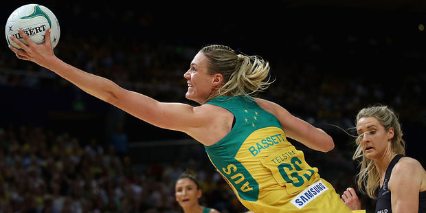 Caitlin Bassett of the Diamonds stretches to catch the ball against the Silver Ferns. Photo / Getty