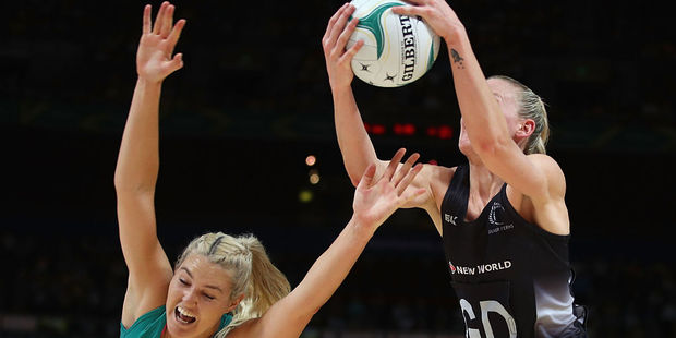 Gretel Tippett of the Diamonds and Katrina Grant of the Silver Ferns compete for the ball. Photo / Getty