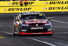 Jamie Whincup takes the chequered flag during the Bathurst 1000. Photo / Getty Images