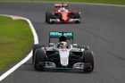 Lewis Hamilton leads Sebastian Vettel at the Japanese Grand Prix. Photo / Getty Images