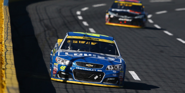 Jimmie Johnson leads a pack of cars during the NASCAR Sprint Cup race at Charlotte. Photo / Getty Images