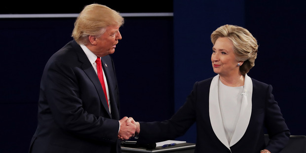 Republican presidential nominee Donald Trump shakes hands with Democratic presidential nominee former Secretary of State Hillary Clinton during the town hall debate. Photo / Getty