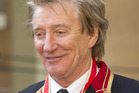 Sir Rod Stewart after he received his knighthood in recognition of his services to music and charity at Buckingham Palace. Photo / Getty Images
