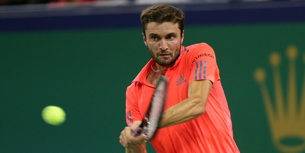 Gilles Simon of France returns a shot against Stan Wawrinka during the Shanghai Masters. Photo / Getty Images