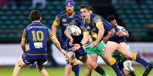 Michael Collins of Otago is tackled by Jason Emery of Manawatu. Photo / Getty