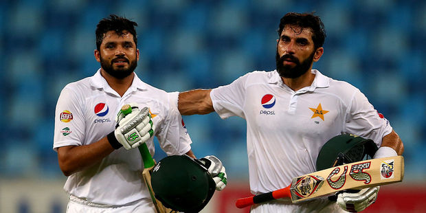 Azhar Ali is congratulated by Misbah-ul-Haq on scoring a triple century. Photo / Getty