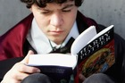 A Harry Potter fan begins to read the novel by author J.K. Rowling. Photo / Getty
