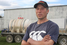 Oamaru dairy farmer Hayden Williams stands in front of his tanker. Photo /  Shannon Gillies.