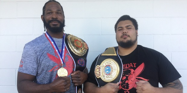 Julius Long, left, and Conrad Lam show off the gold they brought back from the Gold Coast last weekend.
