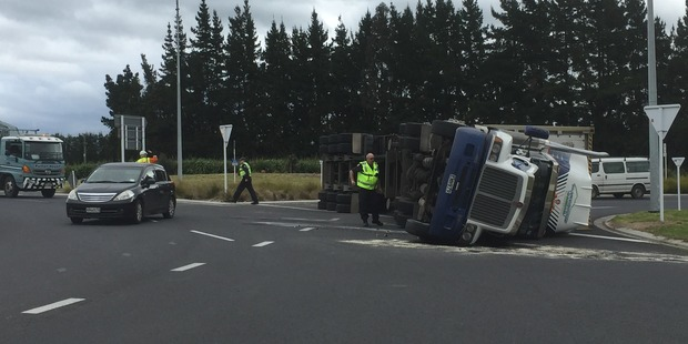A truck rolled at the roundabout intersection of SH2 and SH33 near Paengaroa. Photo/George Novak
