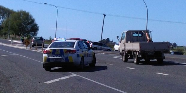 Police are diverting traffic at Bell Rd, Papamoa following a two-car crash. Photo/Andrew Warner