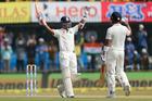Indian batsman Ajinkya Rahane, left, celebrates his century with captain Virat Kohli. Photo / AP