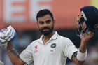 Virat Kohli celebrates the first century of the series. AP/Photo