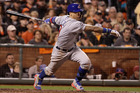 Chicago Cubs' Javier Baez hits a run-scoring single against the San Francisco Giants during the ninth inning of Game 4 of baseball's National League Division Series in San Francisco. Photo / AP