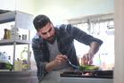 Dariush Lolaiy, chef at Cazador making pheasant Caesar Salad. Photo / Doug Sherring