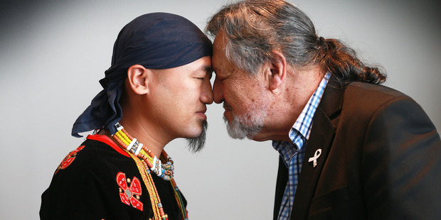 Taiwanese indigenous tribes are long lost cousins of Maori. Pictured is Sauru from the Paiwan Tribe with Sir Pita Sharples at a Taiwan Indigenous Tourism Promotion. Photo / Doug Sherring