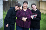 Teri Standen pictured with her son, Reece Standen (left) and daughter, Leah Standen (right), in the backyard of the Hamilton property. Photo / Alan Gibson