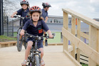 Destinee Payne 6, tests the bridge section of the new cycleway of Gonville School. Tuesday, October 11, 2016 Wanganui Chronicle photograph by Bevan Conley.