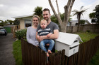 Gemma Mann and Mike Alsweiler with their son Harper outside their new home in Ranui. Picture / Dean Purcell