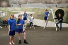 Mural artists Stella Gillard 11(left), Georgia Marsden 11, Zaria Whittaker 11, Annette Brown, Maddison Brown 13 and designer Julie Oliver.