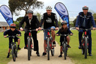 Gonville School pupils Shakhani Te Tue, 6 and Aaria Joseph 6 Hamish McDouall, Olympic cyclist Gary Anderson and Constable Rob Condor at the new Gonville School cycle track.