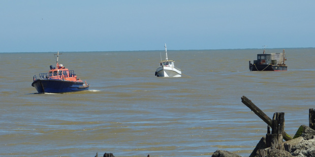The Karere (light boat) towing in the dredge with the current pilot boat in front. PHOTO/LYNNE DOUGLAS